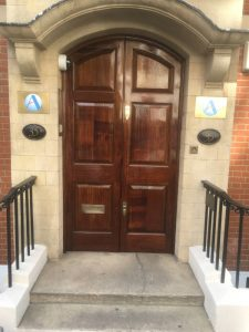 Exterior doors restained and varnished - After