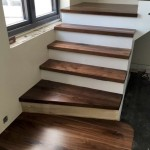 New walnut staircase treads with clear satin finish applied - After.png