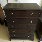 Tall chest of drawers - old dark stained finish